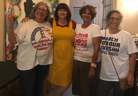 Julie Rogers, Joy Miller, Sylvia Campos and Isabel Araiza pose at the Progressive Center for Studies and Culture during a watch party on Nov. 6, 2018. Miller (District 1) and Campos (District 2) are headed for the runoff election.