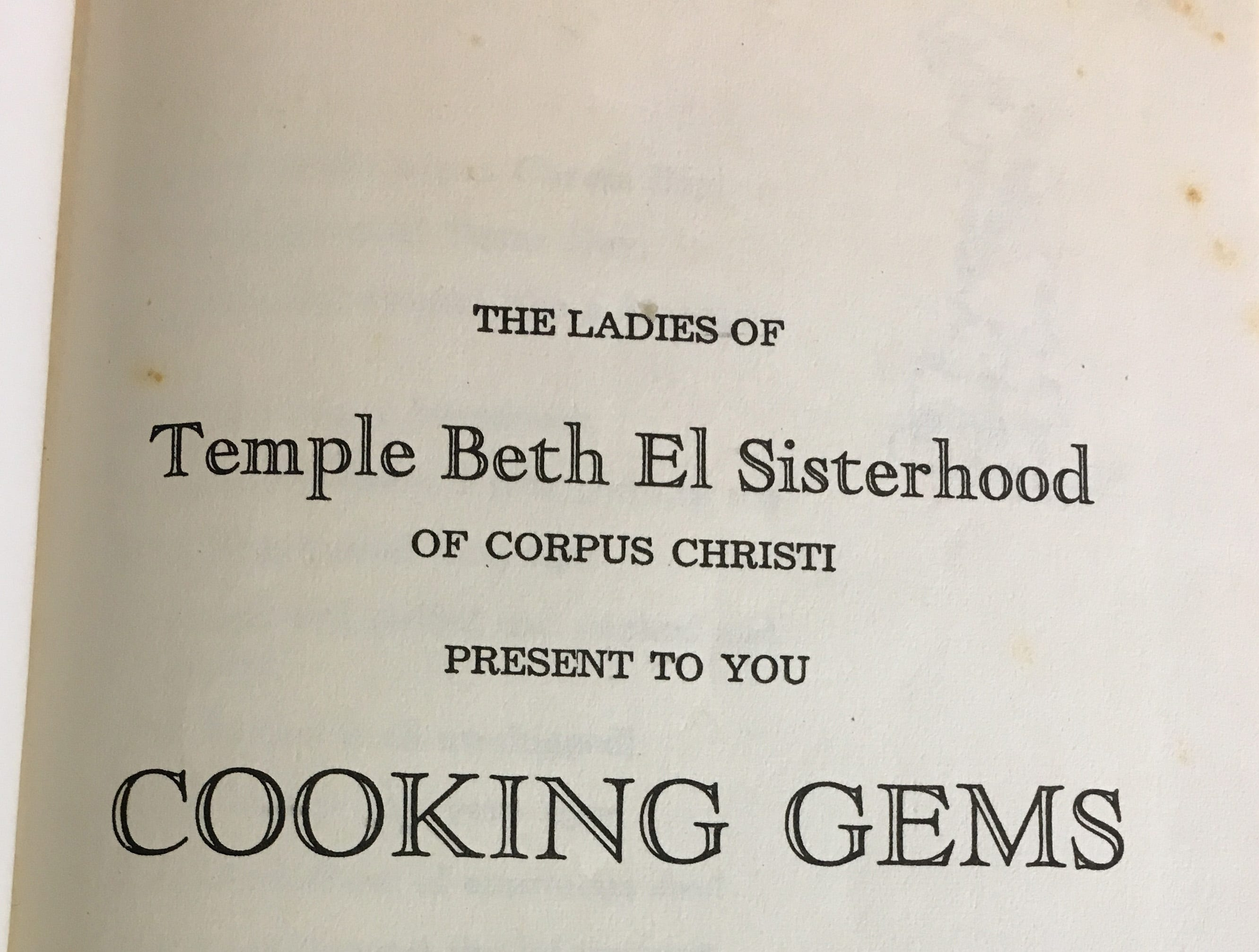 "The cover page of the Temple Beth El Sisterhood cookbook ""Cooking Gems"" published in 1951."