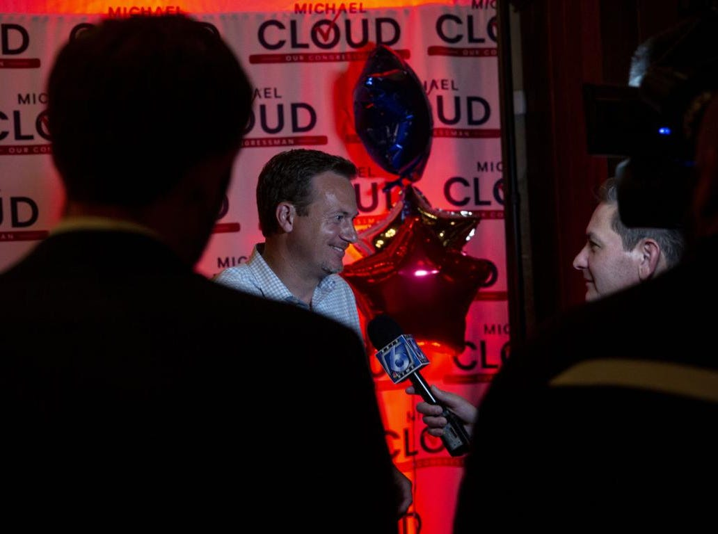 U.S. Rep. Michael Cloud is interviewed by reporters during his watch party at Soiree events center in downtown Victoria.