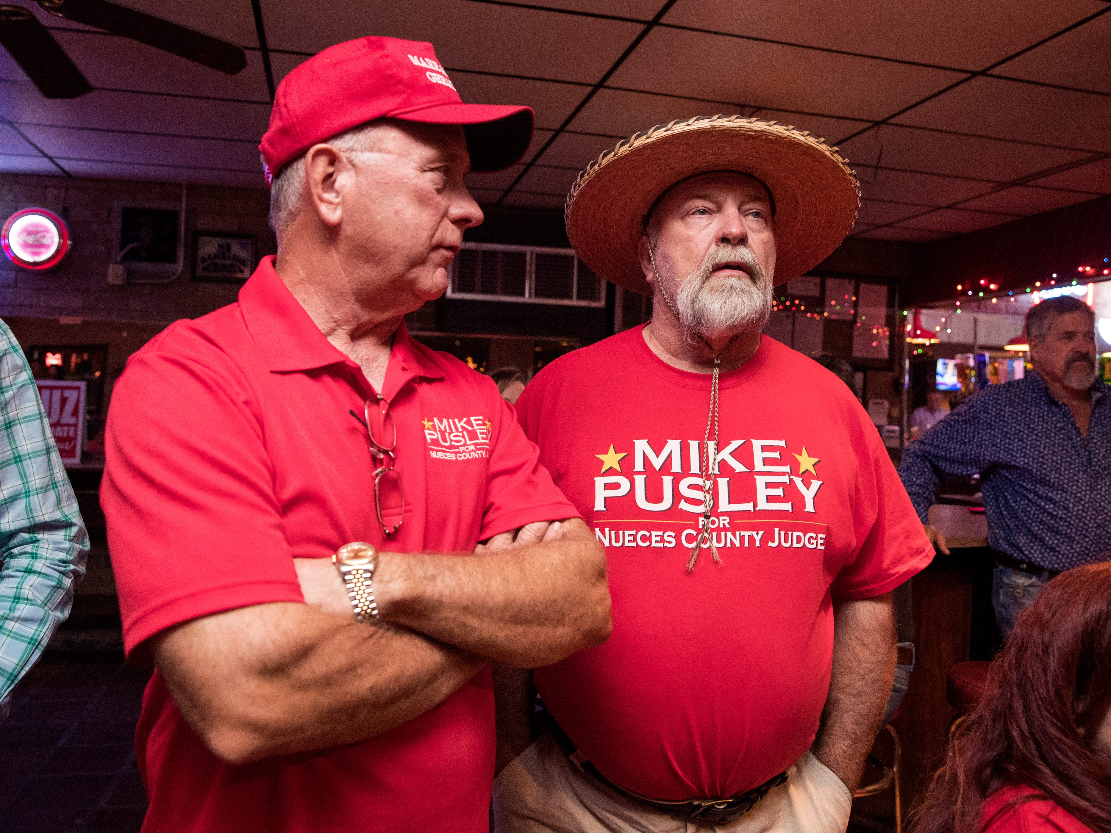 Republican candidate for Nueces County Judge Mike Pusley talks with his brother, Lance Pusley, about early voting numbers at the Bar-B-Q Man on Tuesday, November 6, 2018.