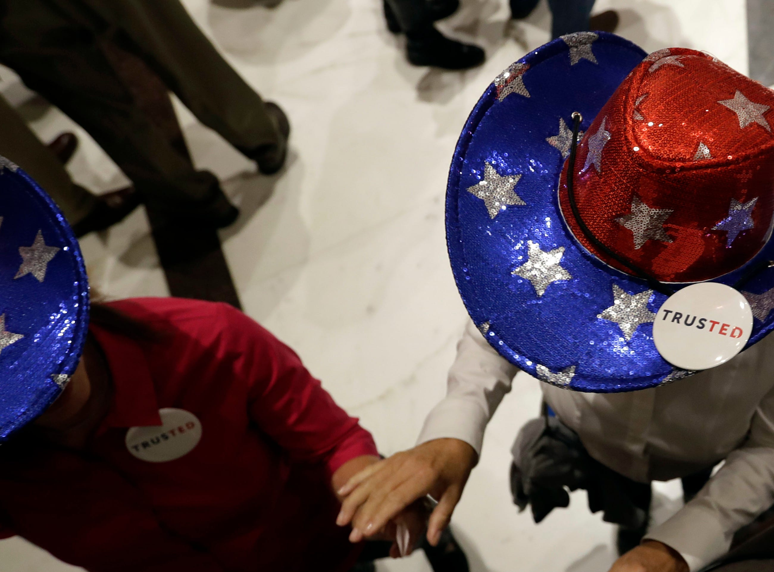 Supporters of Sen. Ted Cruz, R-Texas, wait to enter an election night party, Tuesday, Nov. 6, 2018, in Houston. (AP Photo/David J. Phillip)