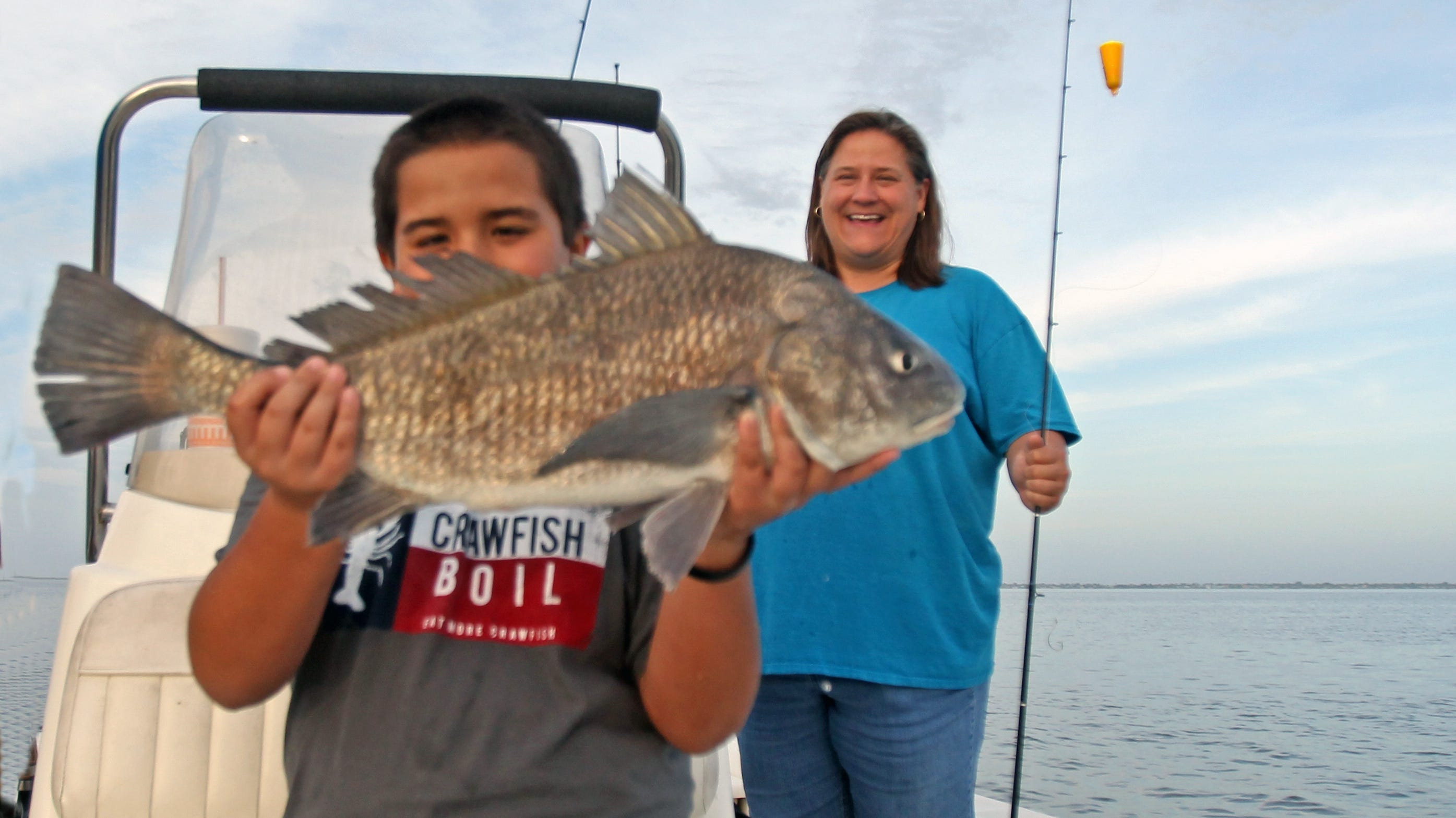 Jacob and his mom, Madonna Moore, enjoyed a free guided fishing trip paid for by a couple of South Texas anglers.