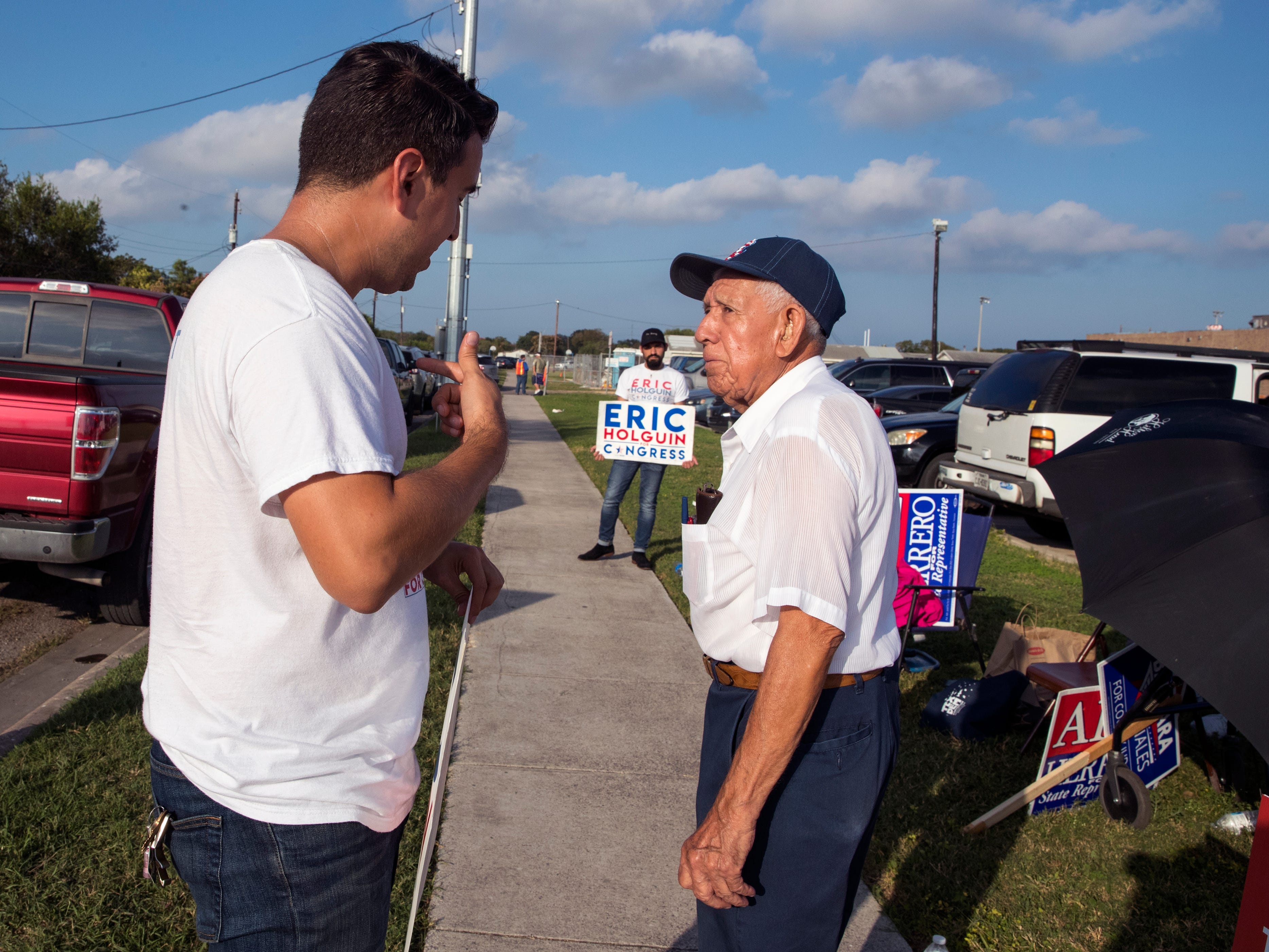 Eric Holguin (left), Democratic candidate for Texas' 27th Congressional District, talks with voter Frank Salazar outside Moody High School on Tuesday, November 6, 2018.