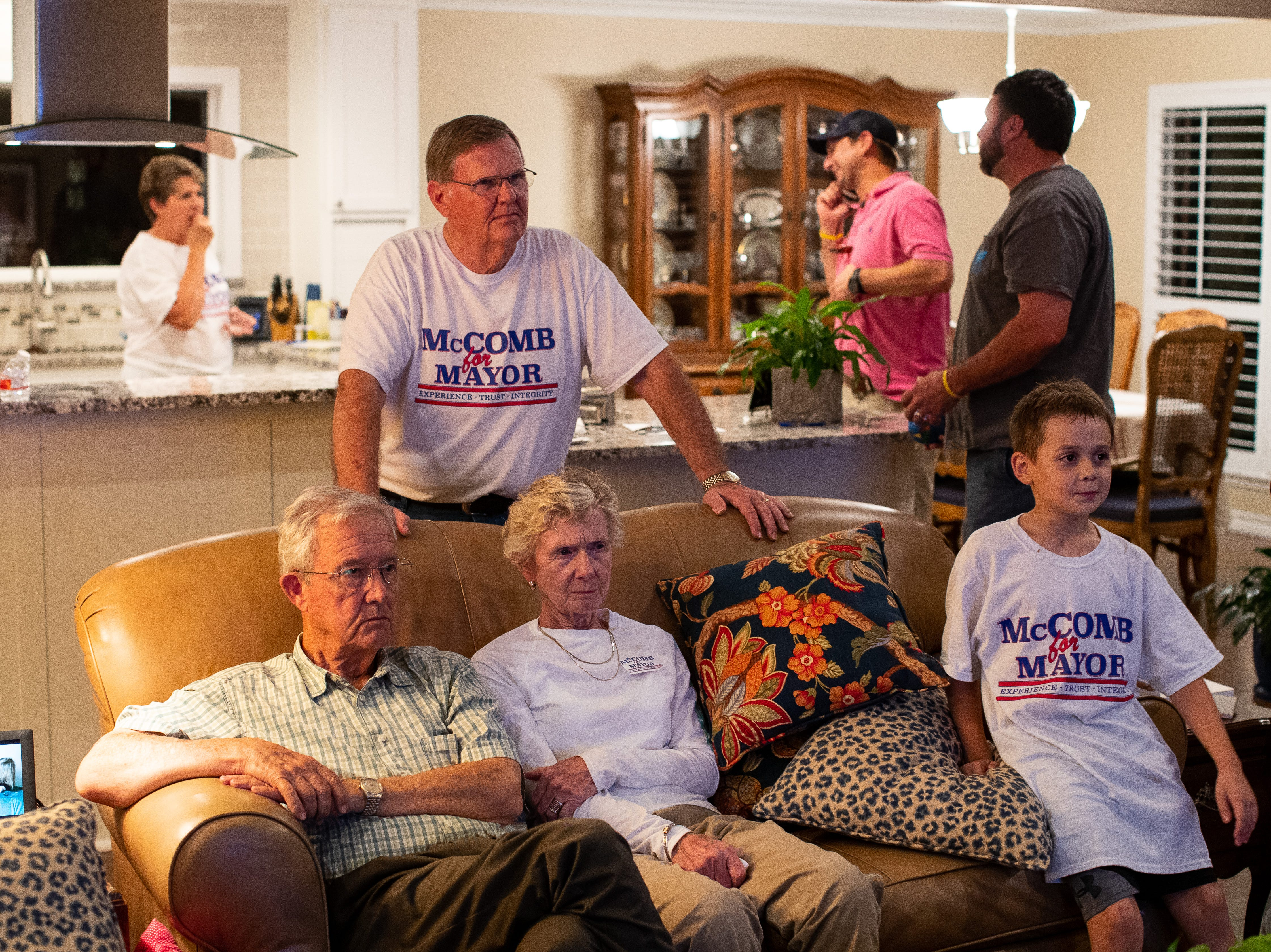 Corpus Christi mayor Joe McComb with friends and family watch as voting members come in putting him under 51% forcing a run off.