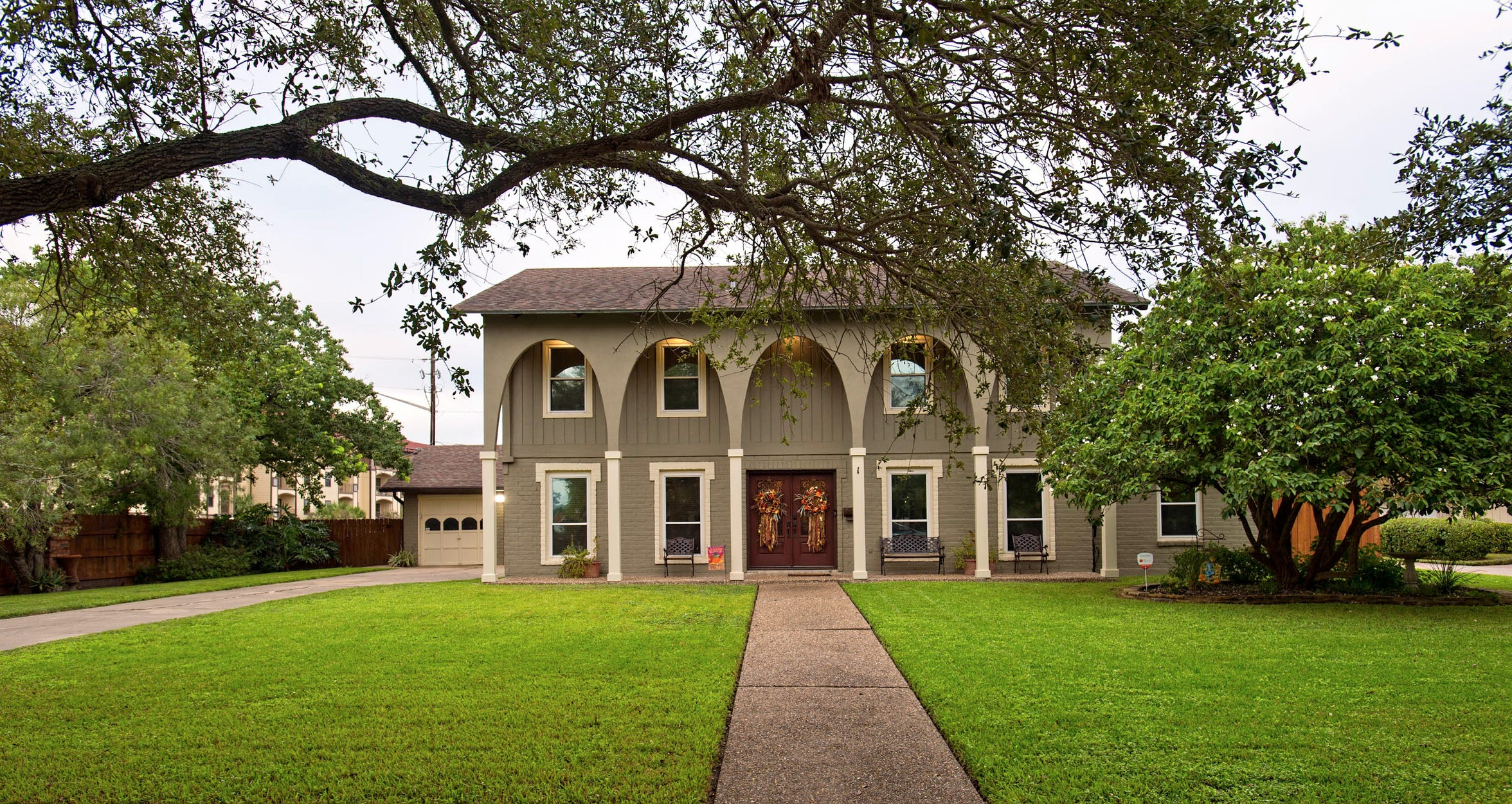 The stately 2 story home at 1 Camden sits on a tree shaded lot, steps from Ocean Dr./ Corpus Christi Bay