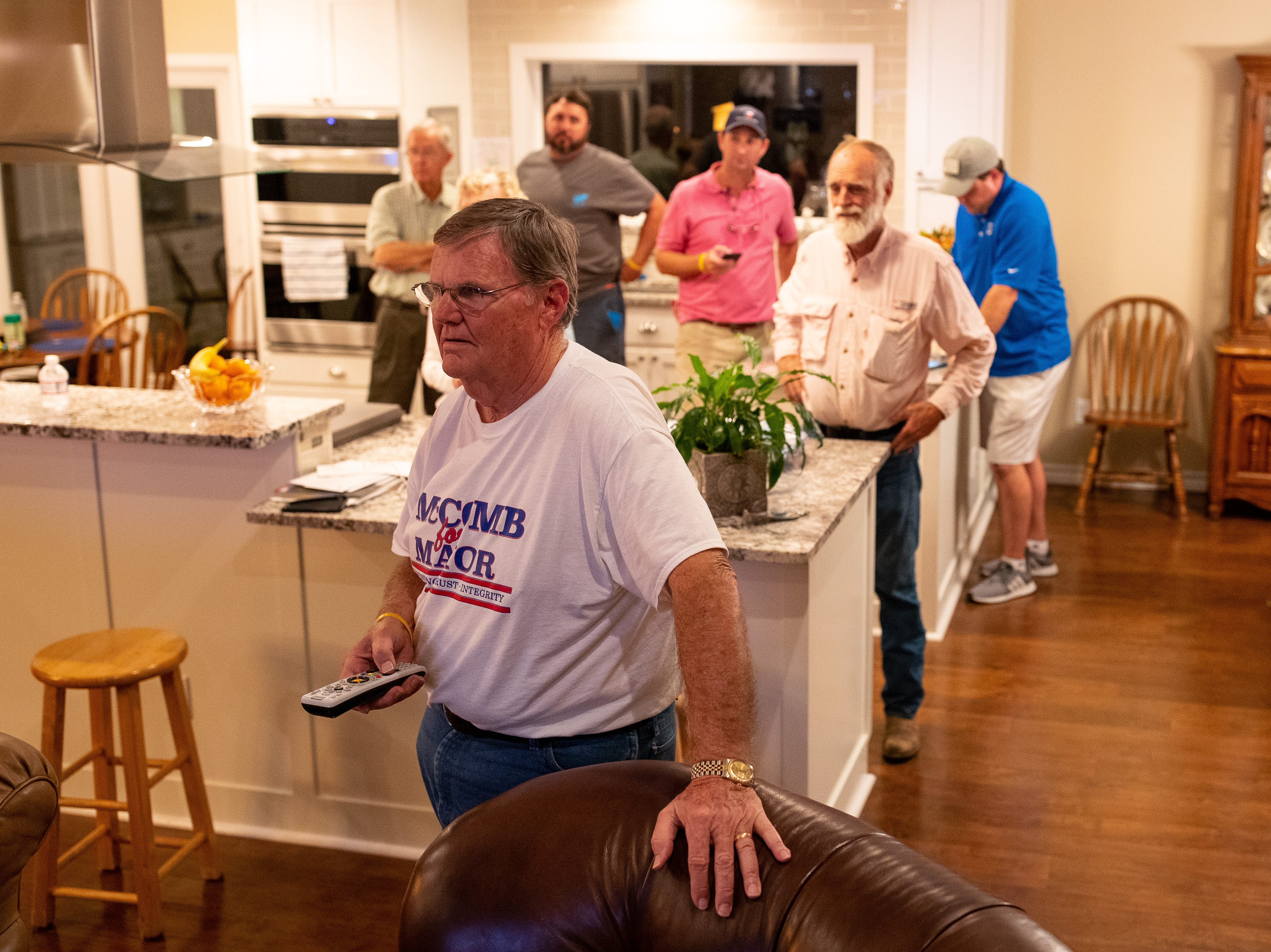 Corpus Christi mayor Joe McComb seeking re-election watches the TV as his lead drops to less then 51% as polling numbers come in on Tuesday, Nov. 6, 2018.