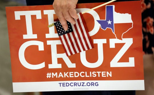 Stuart Mayper holds a sign for Sen. Ted Cruz, R-Texas, during an election night party, Tuesday, Nov. 6, 2018, in Houston. (AP Photo/David J. Phillip)
