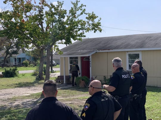 Aransas Pass police and DEA agents serve a search warrant at a home in the 1200 block of West Yoakum Avenue on Nov. 6, 2018.