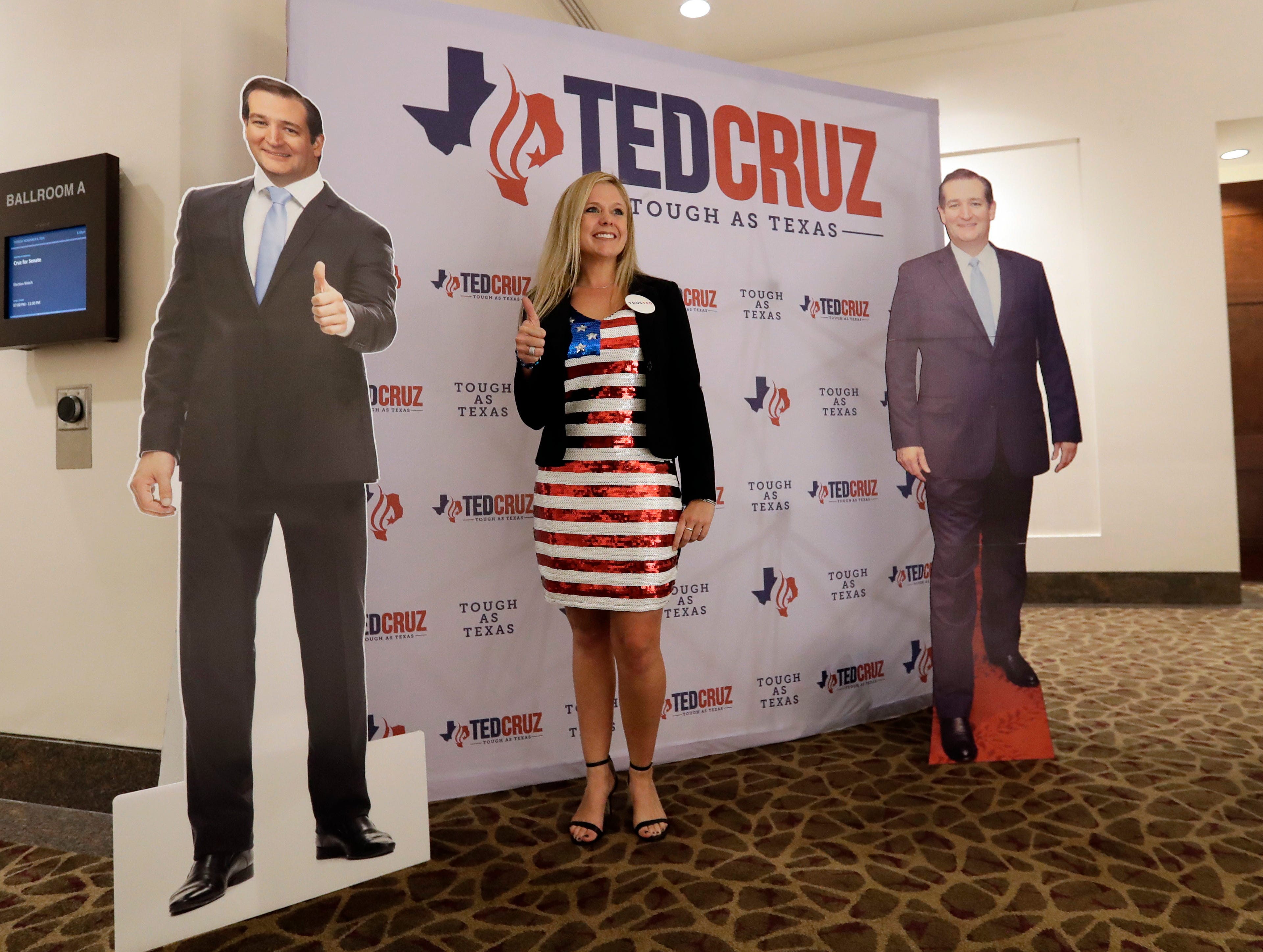 Brittany Lawrence stops to pose in front of a sign for Sen. Ted Cruz, R-Texas, at an election night party, Tuesday, Nov. 6, 2018, in Houston. (AP Photo/David J. Phillip)
