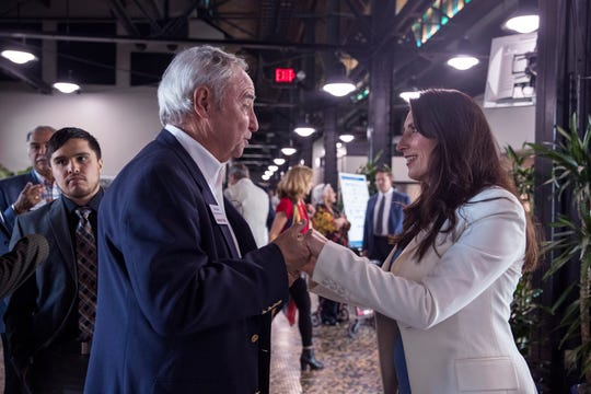 Nueces County Judge-elect Barbara Canales (right) receives congratulations from Alex Harris the day after Election Day following the State of the Port at the Congressman Solomon P. Ortiz International Center. Canales, a Democrat, received 4,407 more votes than Republican candidate Mike Pusley.