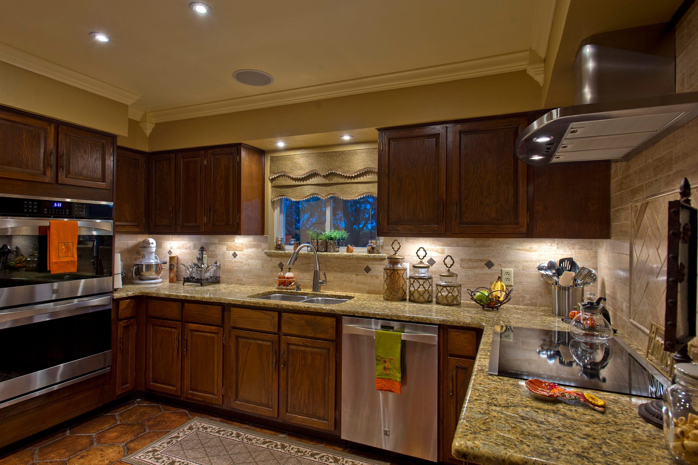 The huge kitchen is a made for the cook, easy for entertaining w/granite tops, wine cooler, double ovens, breakfast bar, buffet counter & more!