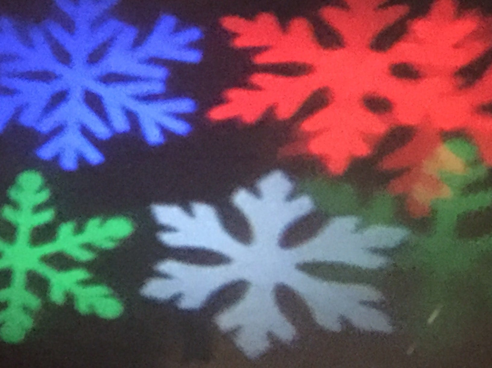 Snowflakes illuminate a wall at G Boys Animation Wonderland at McNaughton's Garden Center in Cherry Hill.