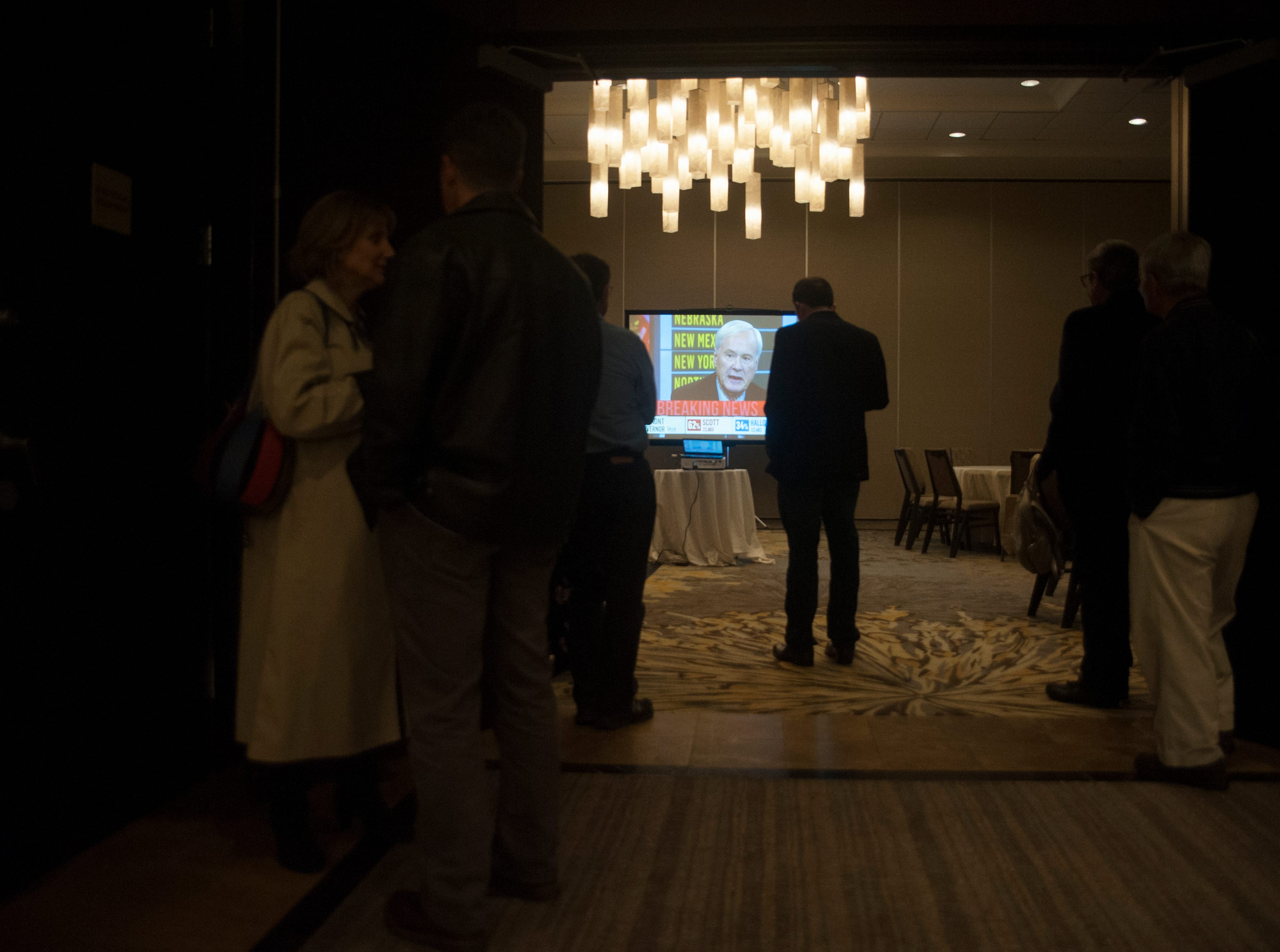 A small crowd gathers to watch election results in a ballroom of the Westin Mount Laurel, the election night headquarters of Democratic 3rd Congressional District candidate Andy Kim on Tuesday, November 6, 2018.