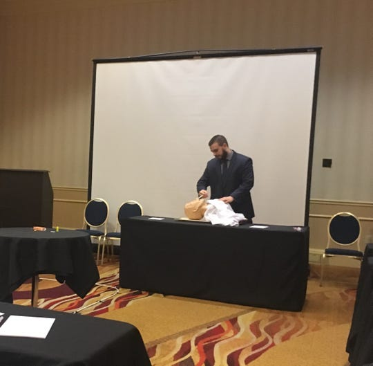 """Burlington County Prosecutor's Office detective Steve Laramie gives a demonstration of how to administer Narcan to an overdose victim at The Hotel ML on Wednesday. The Prosecutor's Office unveiled a new program called """"Operation Safe Overnight"""". Each Burlington County hotel and motel gets a free Narcan kit, to help save overdose victims, courtesy of Virtua."""