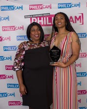 CAMMY award winner Rhonda Gibson-Phifer (right) of Lawnside has a photo op with nominee Constance Komm after picking up the CAMMY Inclusion Award for her community talk show.