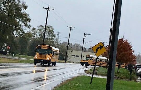 Forest Hills Local School District buses, seen here Nov. 1, 2018, pull out of the school district's new transportation center at 3652 Round Bottom Road in Newtown.