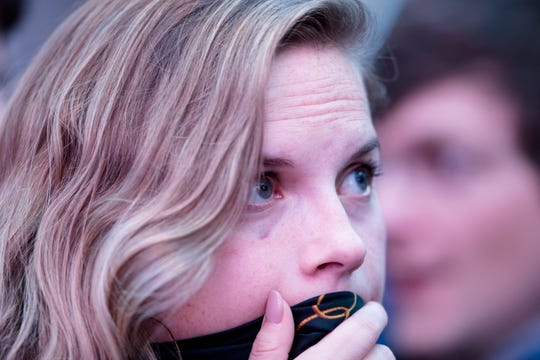 Erin Aleshire of Cincinnati, looks on at election results during Aftab Pureval's  election party on Tuesday, Nov. 6, 2018, in Cincinnati.