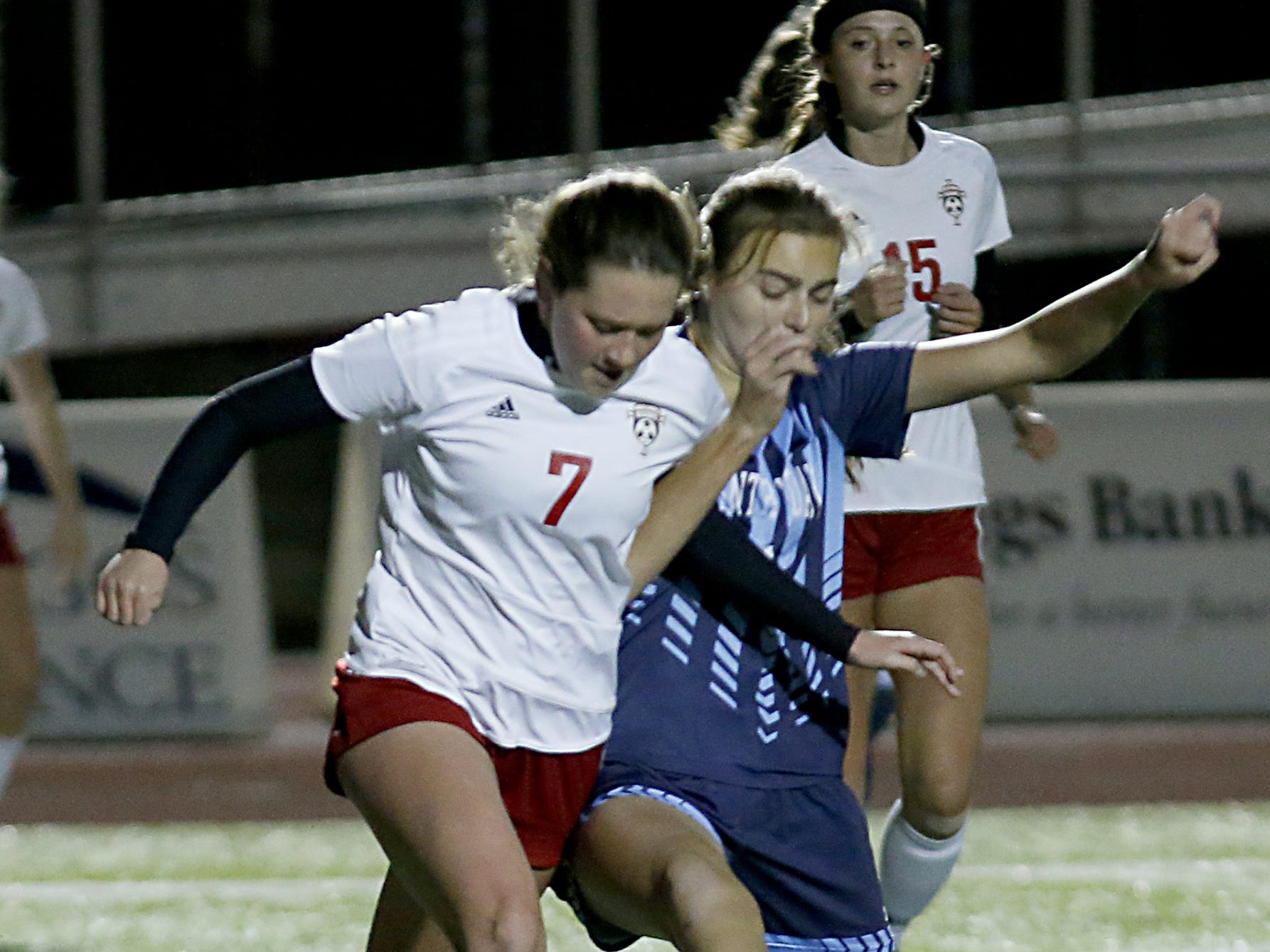 Cincinnati Country Day forward Lawson Renie and Bishop Rosecrans defender Allie Berry battle for possession during their girls division III state semifinal at London Tuesday, Nov. 6, 2018.