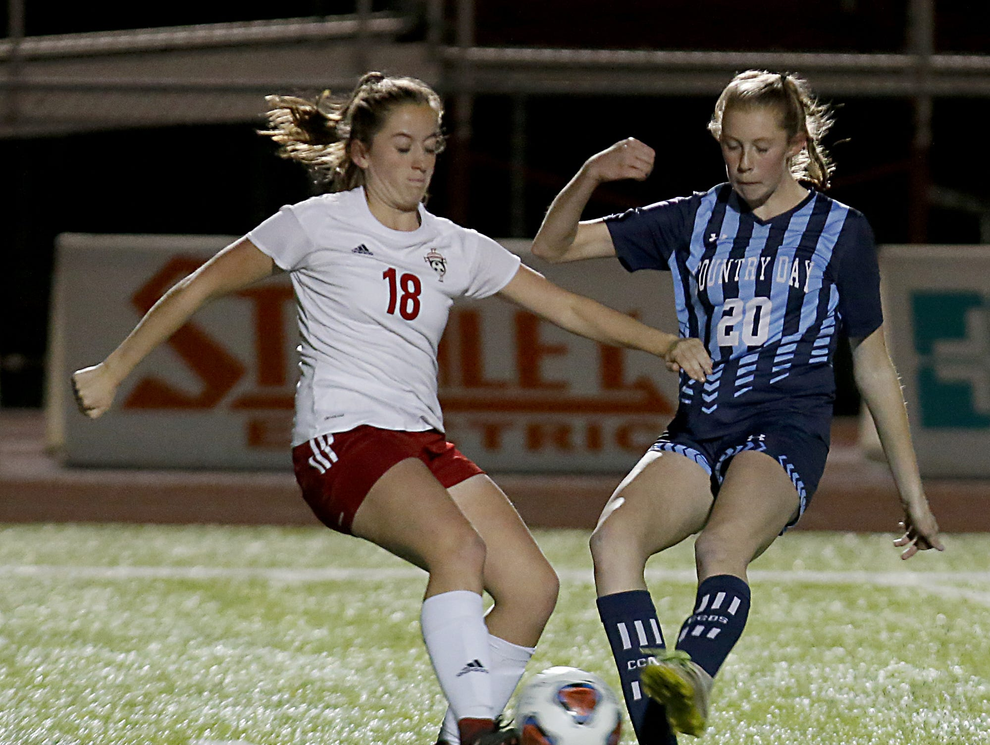 Bishop Rosecrans defender Gracie Milam and Cincinnati Country Day midfielder Sarah Zimmerman converge at the ball during their girls division III state semifinal at London Tuesday, Nov. 6, 2018.