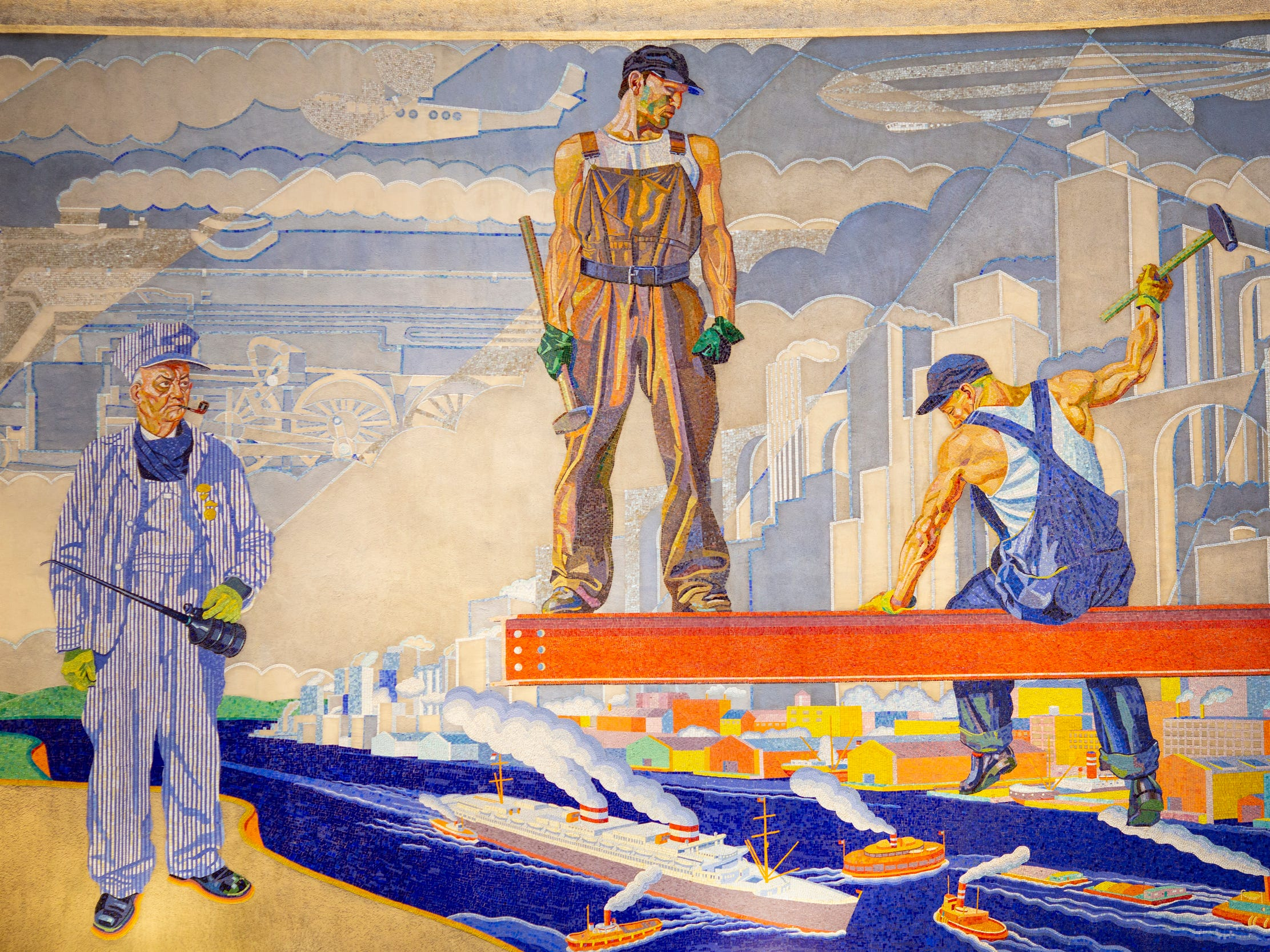 Crews spent about six weeks restoring, repairing and cleaning each side of the Winold Reiss mosaic murals inside the rotunda of the Cincinnati Museum Center at Union Terminal.