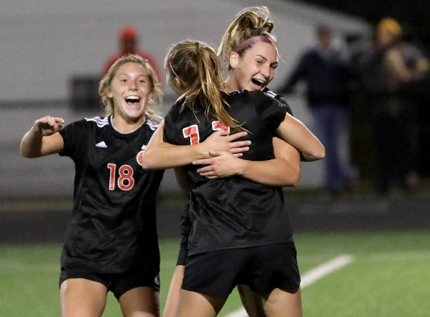 Indian Hill's Eillie Podojil (18)  and her teammates celebrate after a goal during their state semifinal against Big Walnut, Tuesday, Nov. 6, 2018.