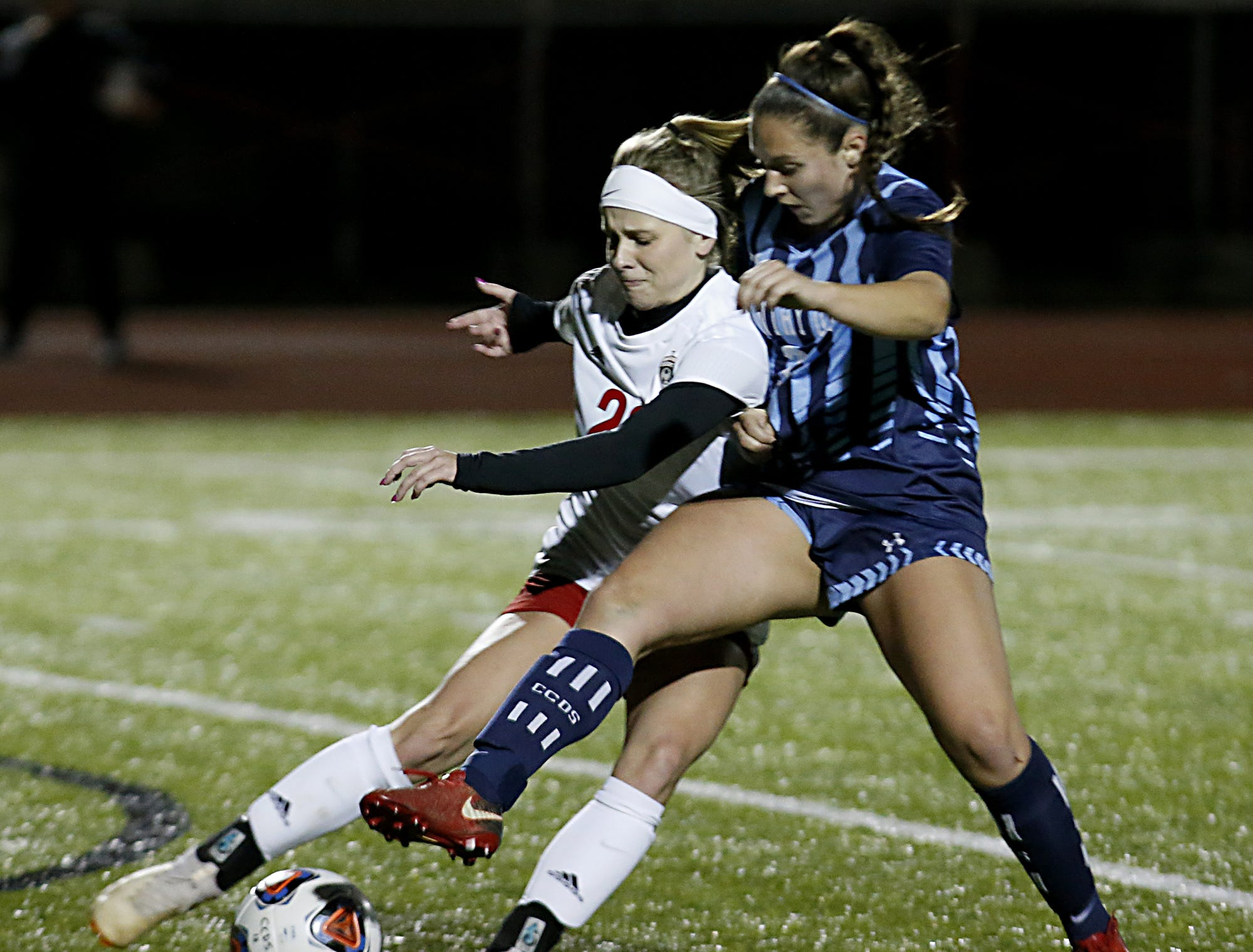 Cincinnati Country Day midfielder Chloe Webb tries to make a play on Bishop Rosecrans midfielder Claire Creeks during their girls division III state semifinal at London Tuesday, Nov. 6, 2018.