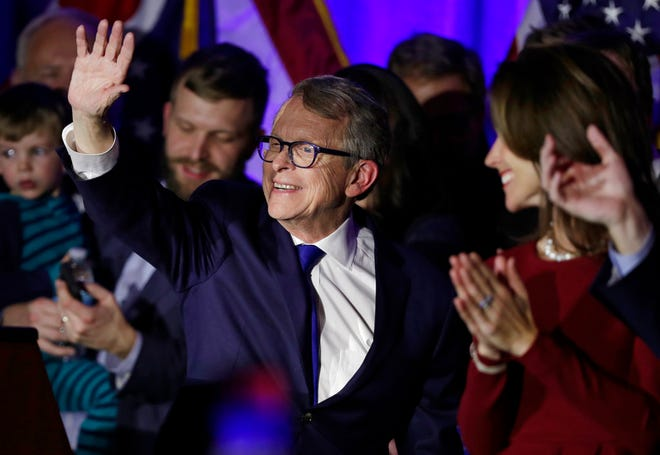 Governor-elect Mike DeWine waves to supporters after speaking at the Ohio Republican Party event, Tuesday, Nov. 6, 2018, in Columbus, Ohio.