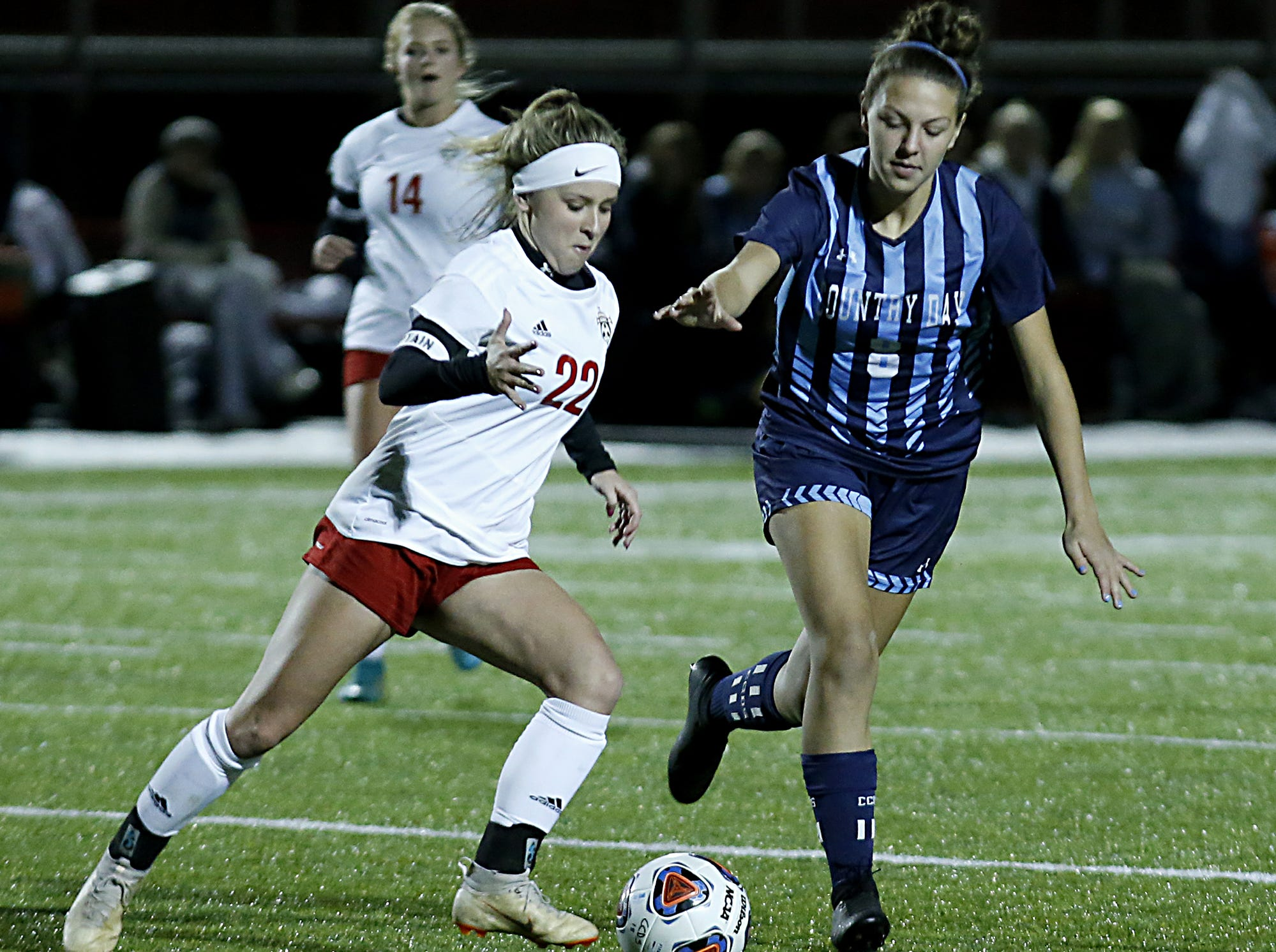 Cincinnati Country Day defender Emma Robinson pursues Bishop Rosecrans midfielder Claire Creeks during their girls division III state semifinal at London Tuesday, Nov. 6, 2018.
