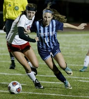 Cincinnati Country Day forward Jenna Setters moves the ball on Bishop Rosecrans midfielder Lily McLaughlin during their girls division III state semifinal at London Tuesday, Nov. 6, 2018.