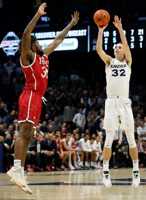 Xavier Musketeers forward Ryan Welage (32) shoots for three in the second half of the NCAA season-opening basketball game between the Xavier Musketeers and the IUPUI Jaguars at the Cintas Center in Cincinnati on Wednesday, Nov. 7, 2018. Xavier won 82-69.