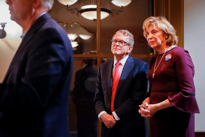 Ohio Attorney General and Republican gubernatorial candidate Mike DeWine, center, and his wife Fran, right, listen as Sen. Lindsey Graham, R-S.C., left, speaks during a campaign event, Tuesday, Oct. 30, 2018, in downtown Cincinnati. (AP Photo/John Minchillo)
