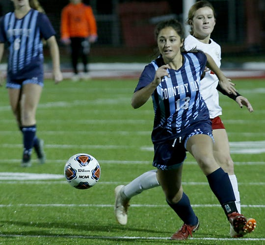 Cincinnati Country Day defender Janie Reiring chases the ball against Bishop Rosecrans during their girls division III state semifinal at London Tuesday, Nov. 6, 2018.