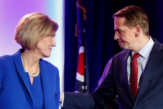 Ohio Democratic gubernatorial candidate Richard Cordray, right, reacts alongside his running mate Betty Sutton, left, after conceding defeat to Ohio Republican gubernatorial candidate Mike DeWine during the Ohio Democratic Party election night watch party, Tuesday, Nov. 6, 2018, in Columbus, Ohio. (AP Photo/John Minchillo)