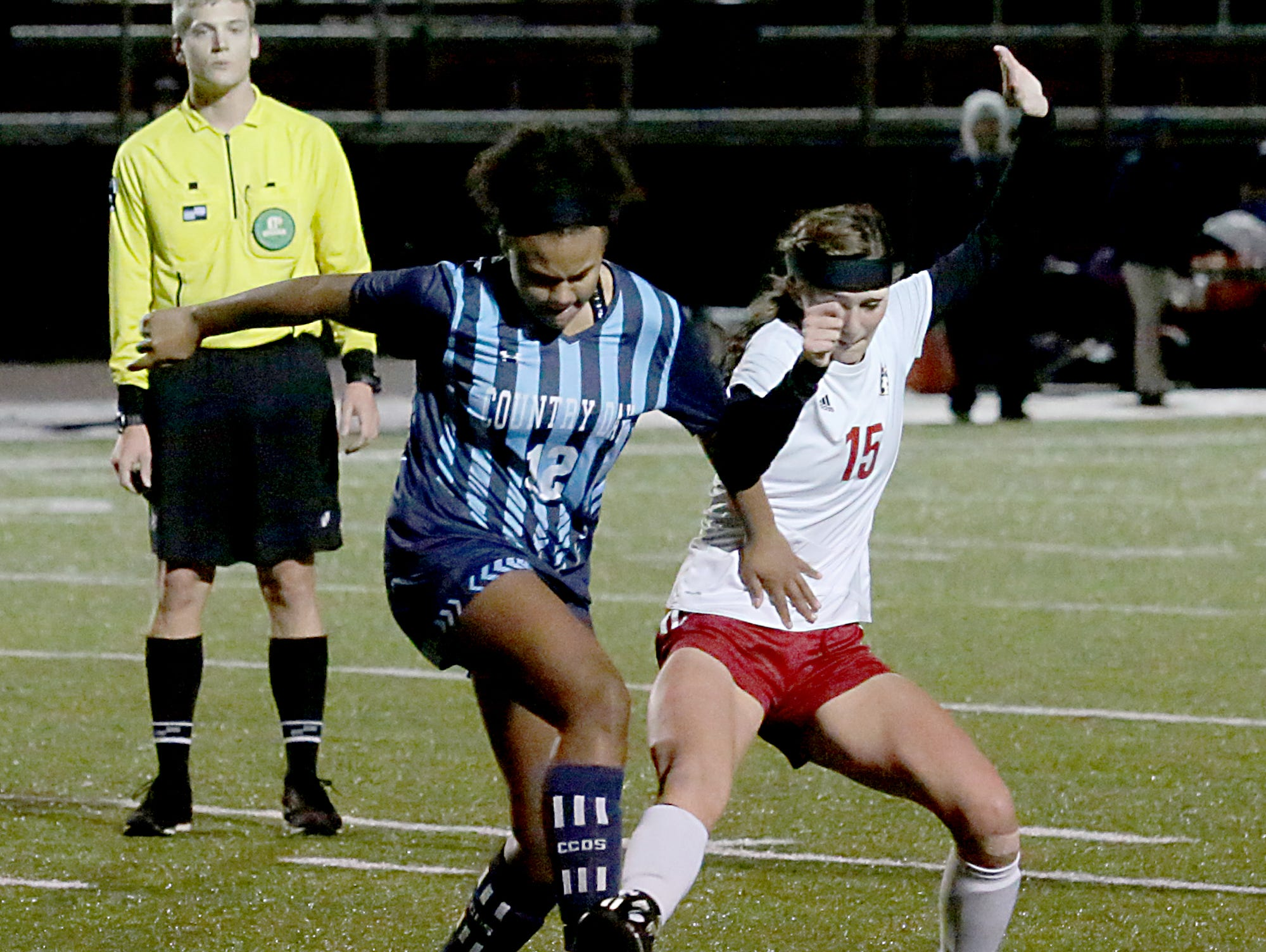 Cincinnati Country Day forward Jada Moorman battles with Bishop Rosecrans midfielder Lily McLaughlin during their girls division III state semifinal at London Tuesday, Nov. 6, 2018.
