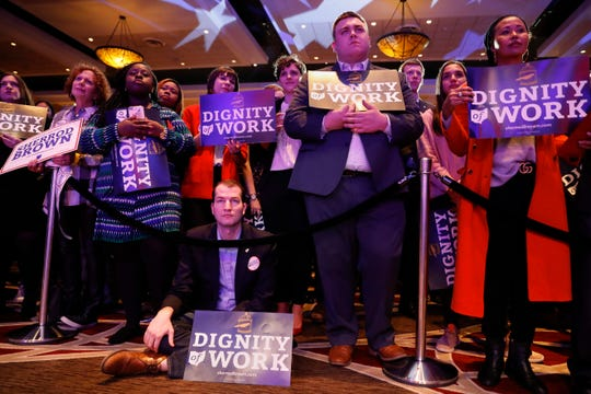 Supporters listen as Sen. Sherrod Brown, D-Ohio, speaks during the Ohio Democratic Party election night watch party, Tuesday, Nov. 6, 2018, in Columbus, Ohio. (AP Photo/John Minchillo)