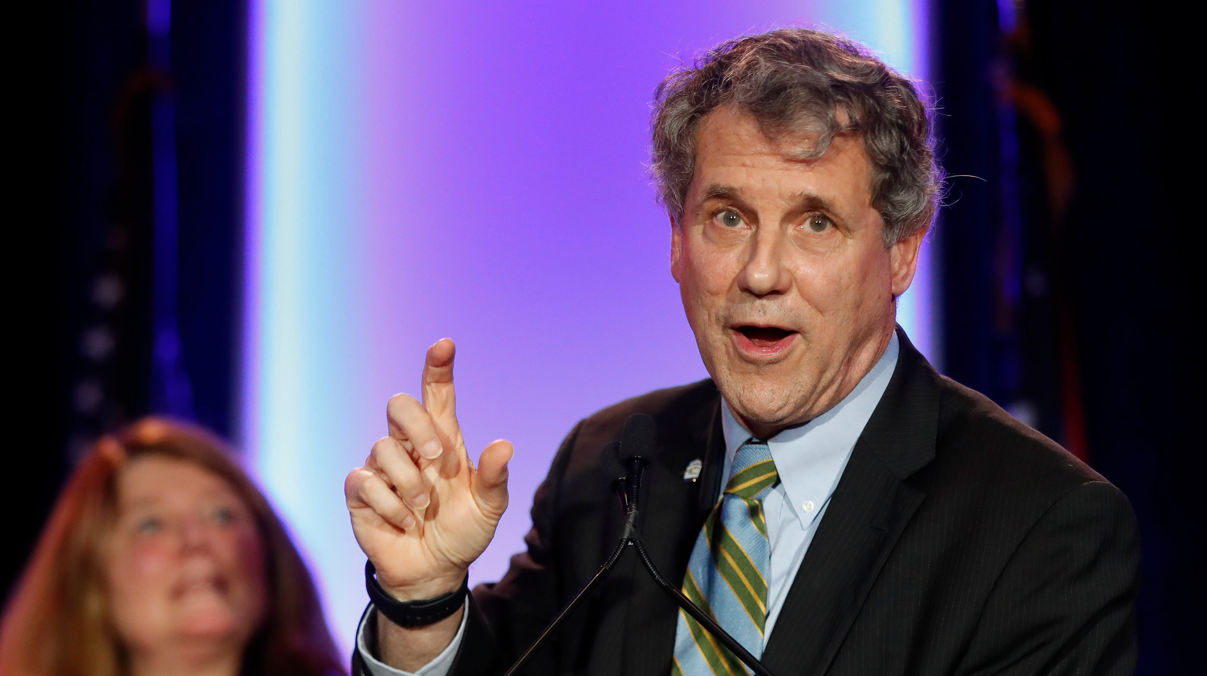 U.S. Sen. Sherrod Brown, D-Ohio, right, speaks alongside his wife Connie Schultz, left, during the Ohio Democratic Party election night watch party, Tuesday, Nov. 6, 2018, in Columbus, Ohio. (AP Photo/John Minchillo)