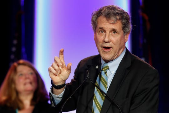 U.S. Sen. Sherrod Brown, D-Ohio, right, speaks alongside his wife Connie Schultz, left, during the Ohio Democratic Party election night watch party, Tuesday, Nov. 6, 2018, in Columbus, Ohio.