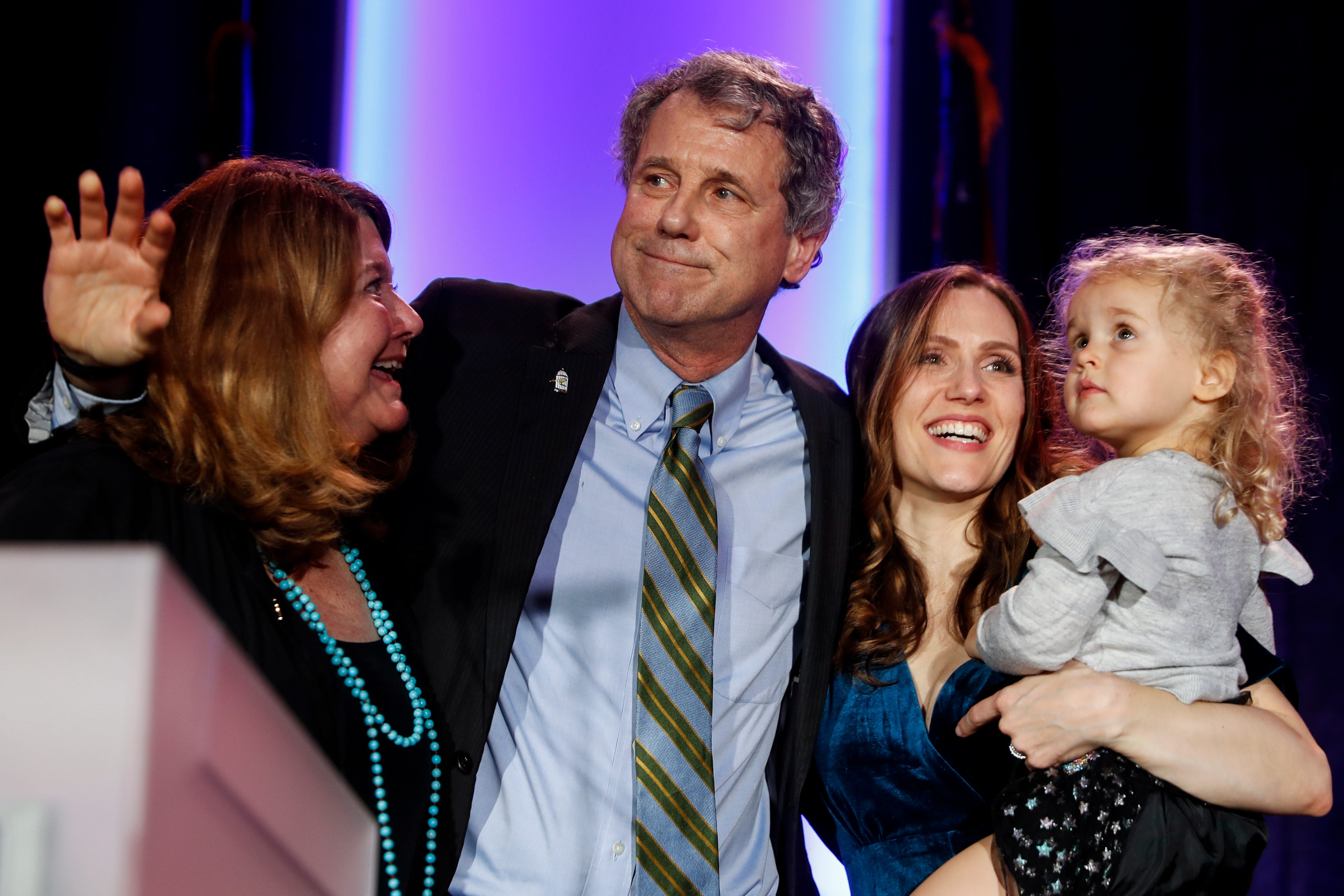 Sen. Sherrod Brown, D-Ohio, hugs his family after speaking to the crowd after winning his reelection bid during the Ohio Democratic Party election night watch party, Tuesday, Nov. 6, 2018, in Columbus, Ohio. (AP Photo/John Minchillo)