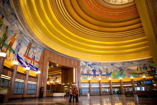 Workers stand in the rotunda of the Cincinnati Museum Center at Union Terminal Monday, November 5, 2018. The $228 million restoration project took more than two and a half years.