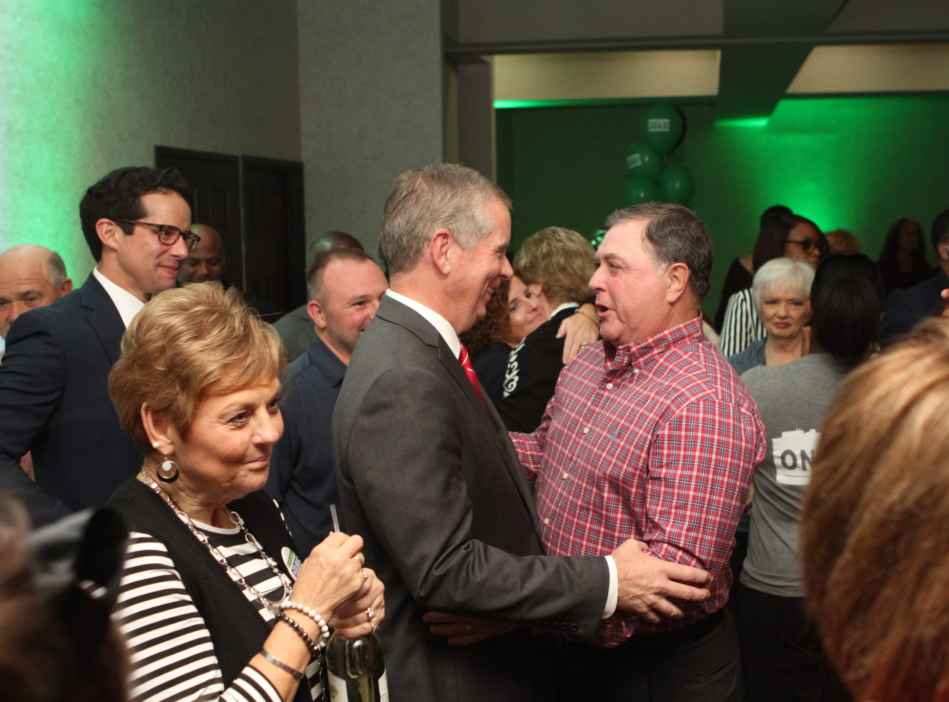 Mayor Joe Pitts is congratulated on his mayoral win by former Mayor Don Trotter at the Riverview Inn on Tuesday, Nov. 6, 2018.