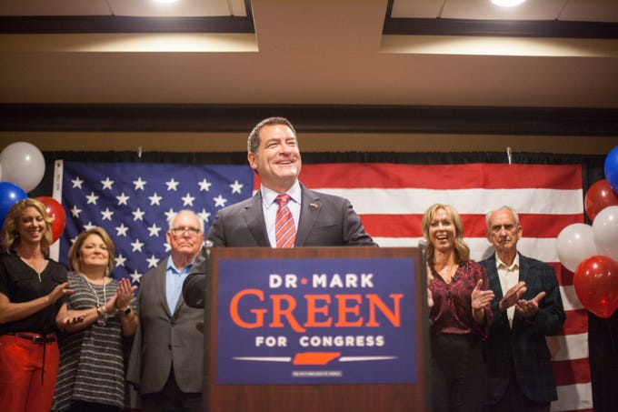 Senator Mark Green takes the stage with his family at the watch party on Tuesday.