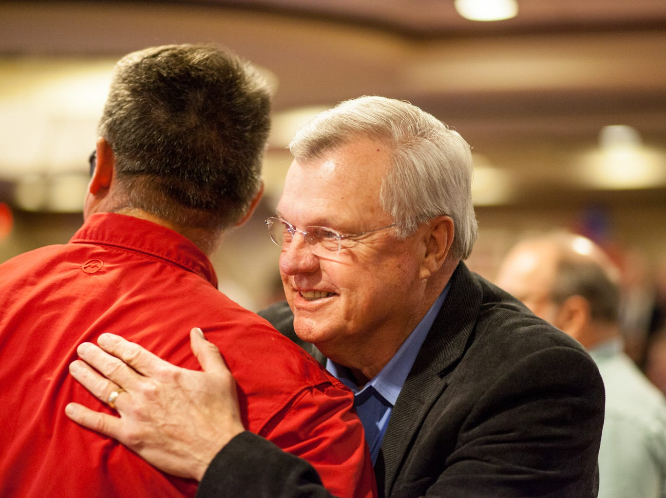 State House District 68 Candidate Curtis Johnson hugs Jay Reedy at the watch party on Tuesday.