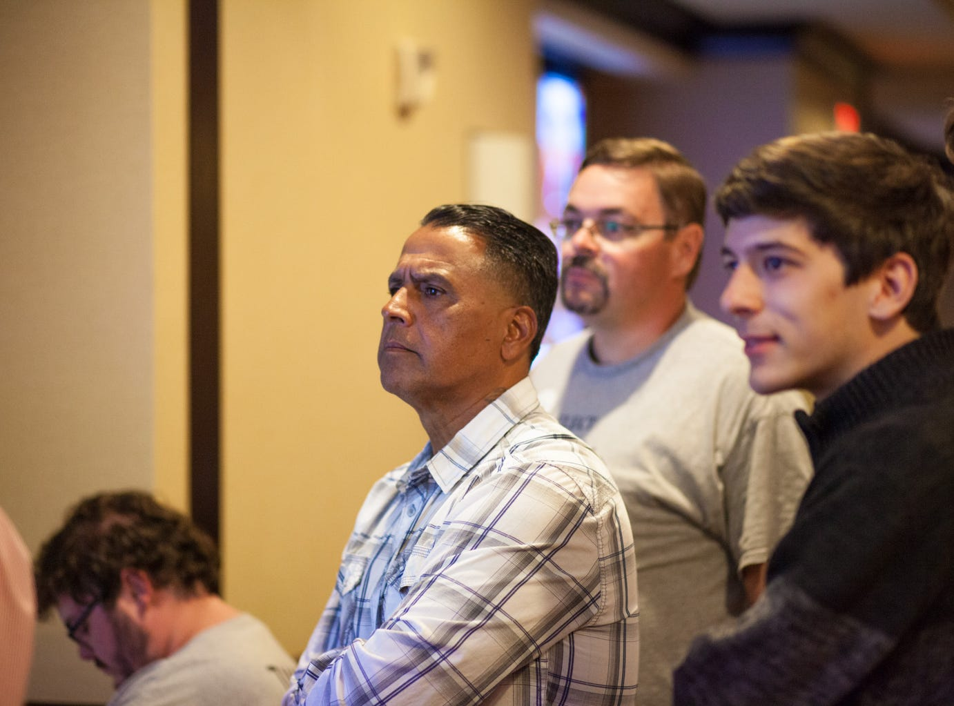 State House District 67 Candidate Tommy Vallejos watches with supporters as results come in at the watch party on Tuesday.