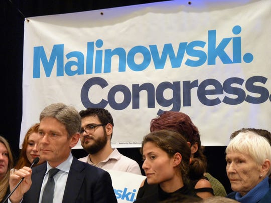 Recently elected Congressman Tom Malinowski, left, with his daughter Emily Malinowski, center, and his mother, Joanna, right.