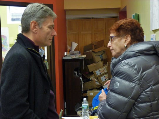 Tom Malinowski speaking with campaign volunteer Carla VIsser, 71, of Somerset, at a Martinsville phone bank on Election Day Nov. 6, 2018.