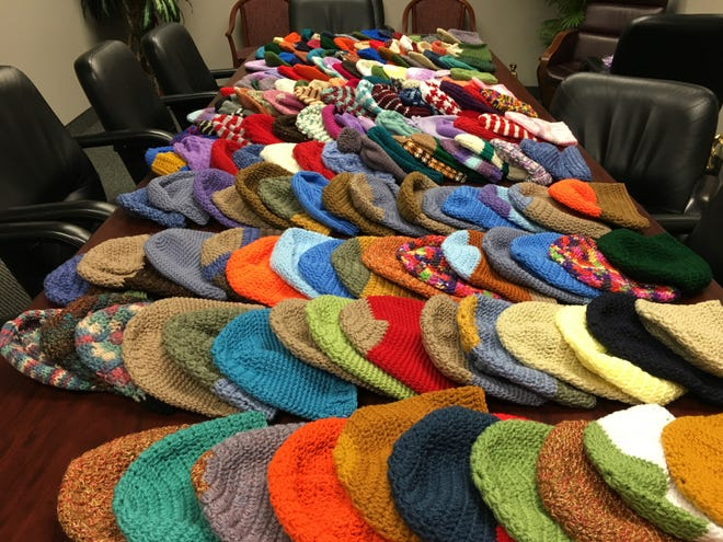 On Wednesday, Nov. 6, we filled our conference room table with 175 hats. We have collected hundreds more this year, thanks to you.