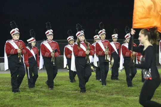 The Marching Trojans take the field for their Homecoming show.