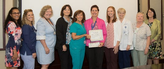 One of the five Magnet Award Winning teams is pictured: Left to right: Joselyn Gonzalez, Tara Maryles, Sally Curtiss,  Deborah Crater, Laura Nunez, Jacqueline Benson, Christina Mera, Roberta Robertozzi, Bonnie Keyes, Mildred Ortu Kowalski
