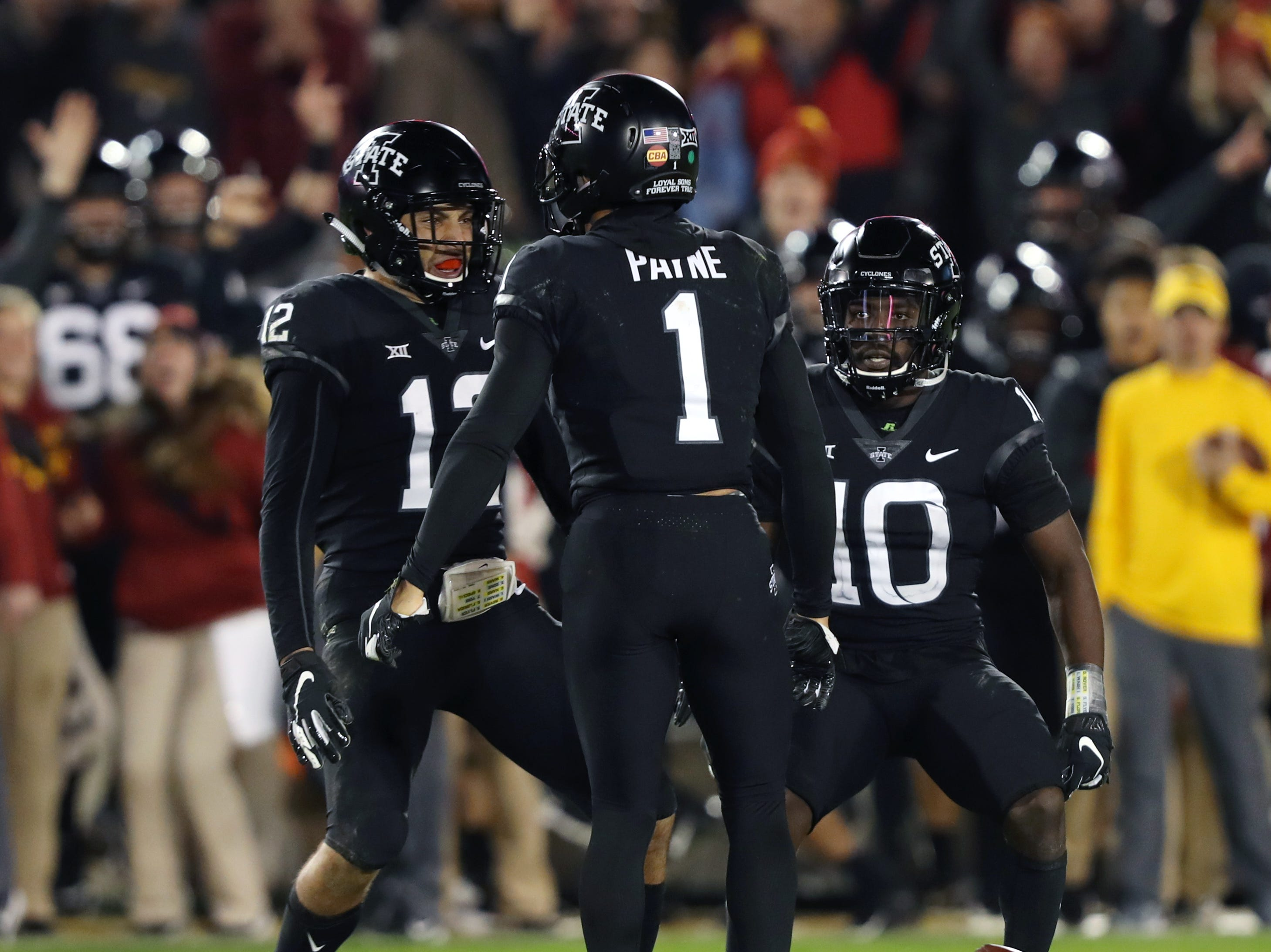 Iowa State Cyclones defensive back D'Andre Payne (1) celebrates with defensive back Greg Eisworth (12) and defensive back Brian Peavy (10) after intercepting a pass in the second half against the West Virginia Mountaineers at Jack Trice Stadium. Iowa State beat West Virginia 30-14.