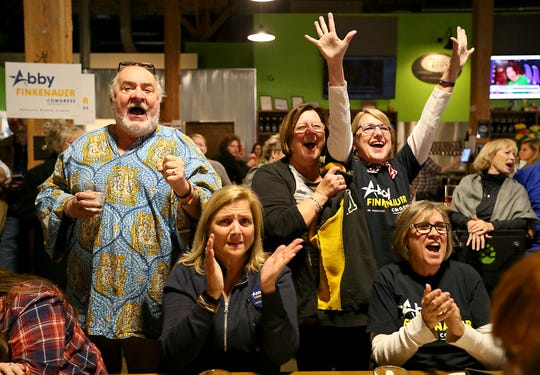 Abby Finkenauer supporters cheer as they watch the results come in at 7 Hills Brewing Co. in Dubuque on Tuesday, Nov. 6, 2018.